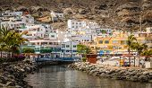 foto of canary  - Small river canal in the Puerto de Mogan - JPG