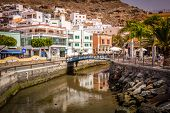 stock photo of canary  - Small river canal in the Puerto de Mogan - JPG