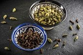 pic of cardamom  - two cups full of spices - JPG