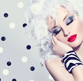 foto of feathers  - Beauty Fashion Model Girl with White Feathers Hair style and bright make up - JPG