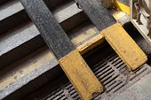 stock photo of stairway  - Urban underpass fragment metal runners for prams and wheelchairs over stone stairway - JPG