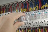 picture of contactor  - Engineer makes maintenance of power network automation - JPG