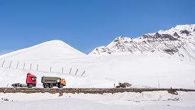 picture of towing  - Truck towing another truck on Georgian Military Highway in northern part of Georgia - JPG