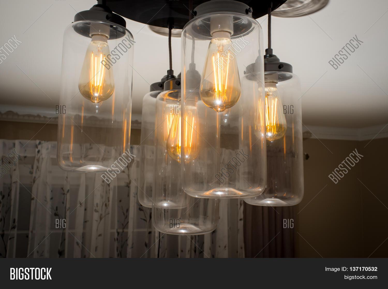Decorative antique style hanging filament light bulb