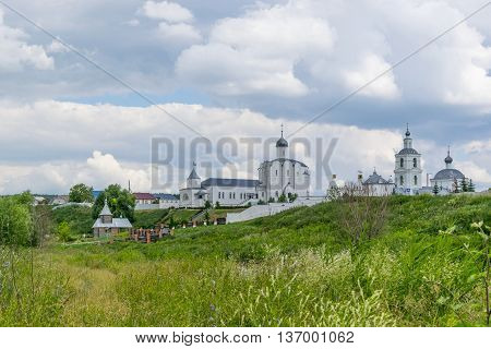 Landscape with the Russian Orthodox Church and cloudy sky. Russian village church