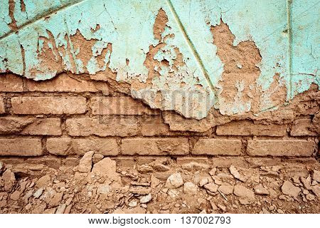 Old Crumbling Red Brick Wall