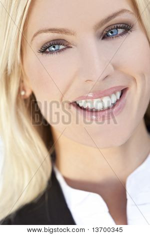Portrait Of Beautiful Happy Young Blond Woman With Blue Eyes