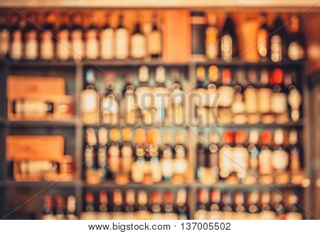blurred wine bottles on the store shelves