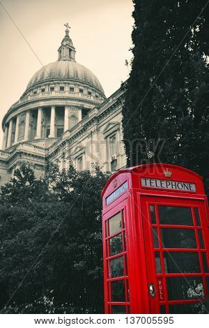 Red telephone booth and St Pauls Cathedral in London.