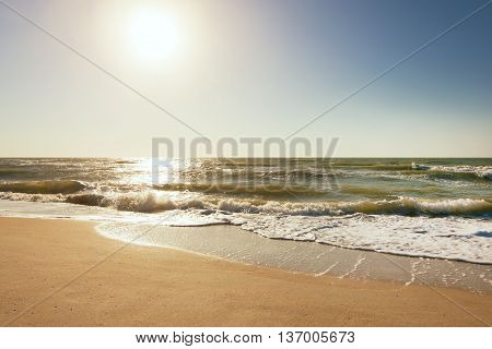 poster of Turquoise sea wave foam on beach. Beautiful water nature. Perfect summer resort for relax. Sea waves near beach. Beautiful sea beach. Summertime, blue sea and waves, yellow sun and sand.