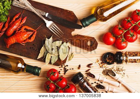 Silverware On The Board With Spices, Cherry Tomatoes And Cancers