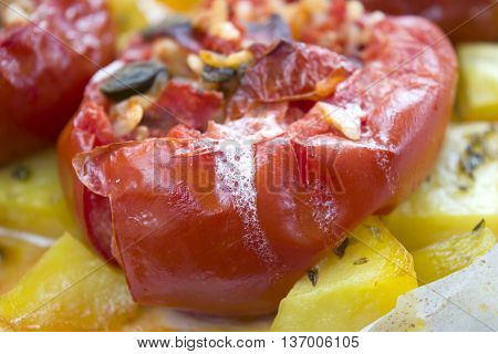 round tomatoes stuffed with rice and mozzarella and baked
