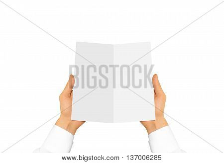 Hand in white shirt sleeve holding blank leaflet in the hand. Offset brochure presentation. Pamphlet hand man. Man show paper. Sheet template. Menu in hands. Booklet design. Fold paper sheet display.