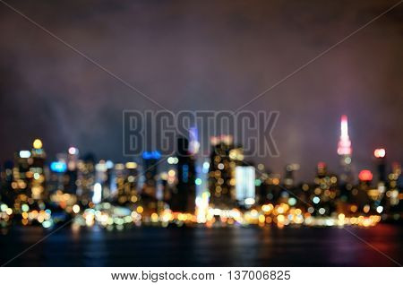 Manhattan midtown skyscrapers and New York City skyline bokeh at night