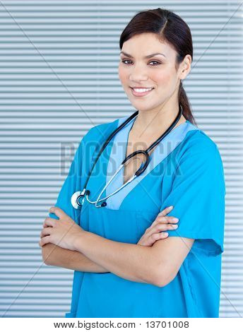 Self-assured female doctor looking at the camera in the hospital
