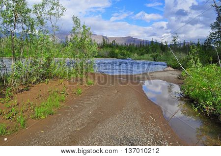 River in mountain taiga. Water landscape Putorana plateau Siberia Russia.