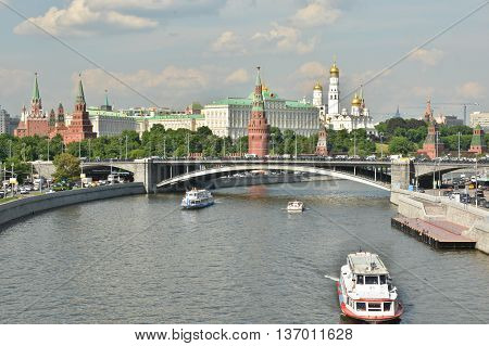 Pleasure craft near the Moscow Kremlin. The embankment of the Moscow river near the Kremlin.