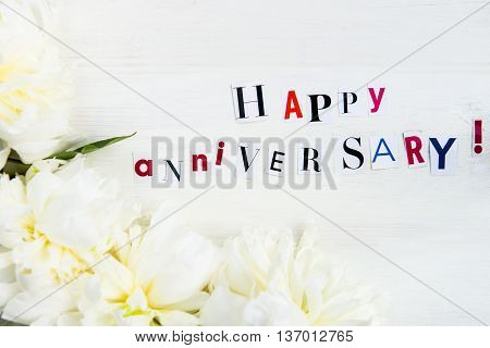 Happy Anniversary Letters Cut Out From Magazines And White Peonies
