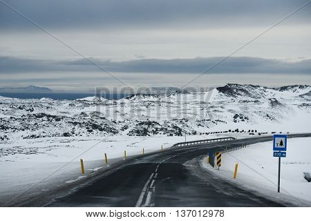 Iced and slippery curve road in winter