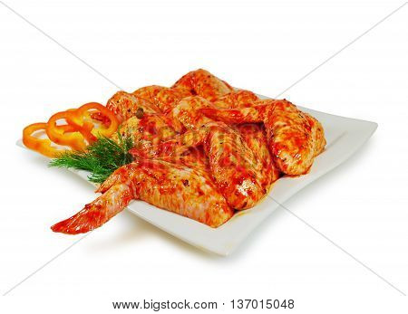Raw meat. Pork escalope slices with sause  in a Dish Isolated Against White Background
