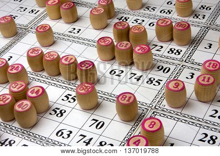 traditional legacy of the ancient Board game Lotto on wooden background
