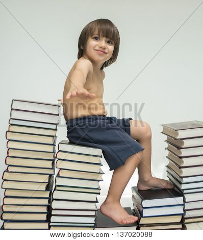 Kid walking steps up a lot of books