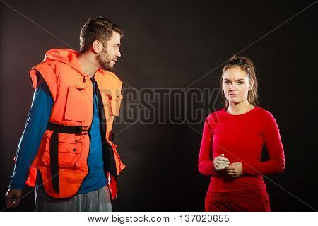 Angry upset man lifeguard shouting screaming at woman lifesaver. Conflict.
