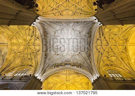 SEVILLE, SPAIN - September 12, 2015: Detail of the ceiling of the majestic Cathedral of Seville on September 12, 2015 in Seville, Spain
