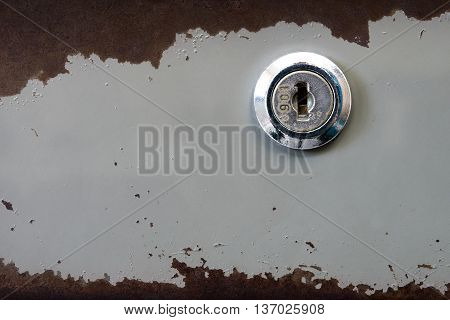 Old key hole of steel cabinet with rust