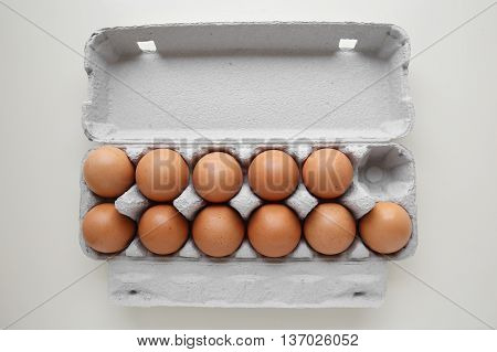 Eggs in packaging with one missing egg