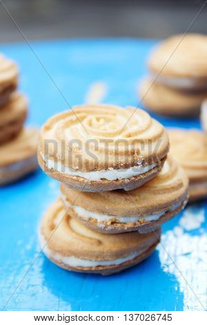 Stack of delicious biscuits with cream. food, junk-food, culinary, baking and eating concept. top veiw