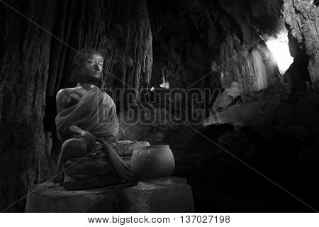 Buddha statue in cave thailand Black&White style