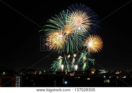 Fireworks Spectacular Blue, Green, Yellow Colors Display Against Black Night Sky