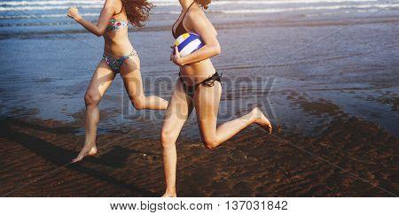 Women Friendship Playing Volleyball Beach Summer Concept
