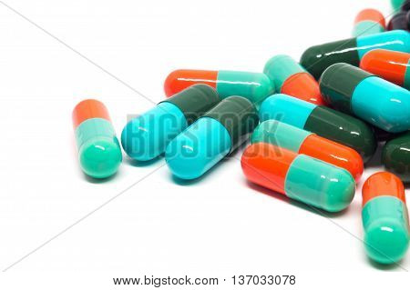 colorful gelatin pills capsules on white background