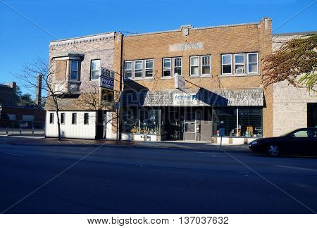 JOLIET, ILLINOIS / UNITED STATES - NOVEMBER 1, 2015: The historic Bensen Building houses Gier Radio and TV, Inc., in downtown Joliet.