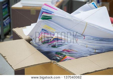 Business concept, Pile of unfinished paperworks in cardbox