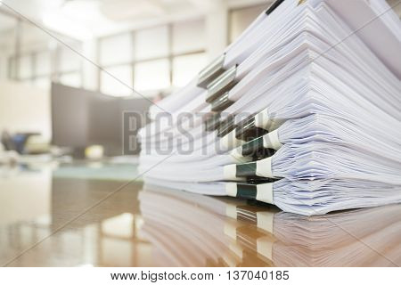 Pile Of Unfinished Documents On Office Desk, Stack Of Businesspaper