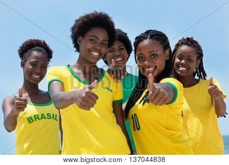 Group of brazilian fans at Copacabana beach at Rio de Janeiro outdoor in the summer