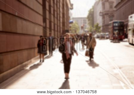Blurred background of crowd of people in the city at rush hour