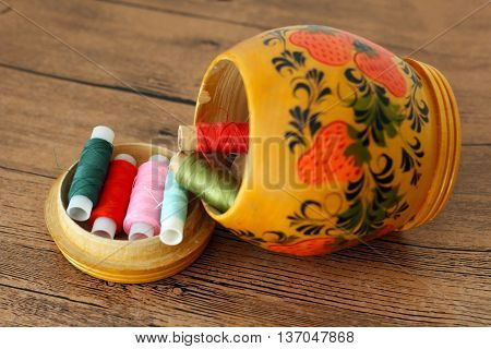 Sewing casket with thread colorful balls indoor