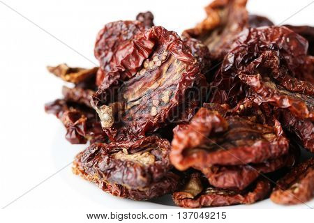 Sun-dried tomato on a white background