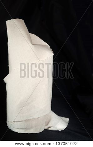 Beige fabric pack isolated over a black background
