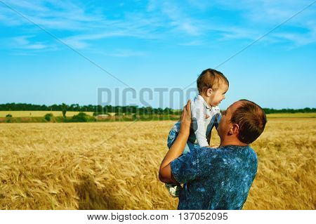The father is talking to his daughter Happy smiling child with the parent. Family portrait.Father's day