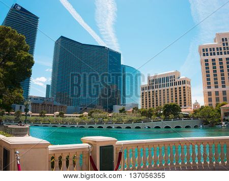 LAS VEGAS, USA - MAY 05, 2016: Hotel Cosmopolitan and people walking on The Strip, the world famous Las Vegas Boulevard South, mostly known for its concentration of resort hotels and casinos along the street route.