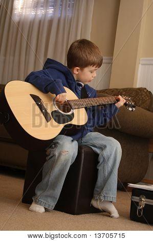 Guitar Playing Boy