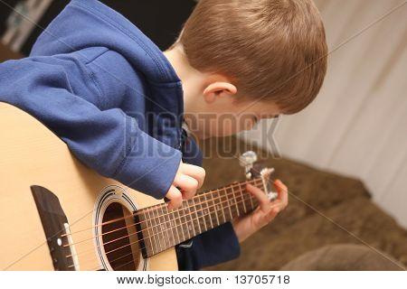 Strumming Guitar Boy