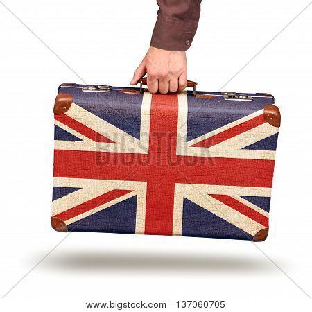 Hand holding vintage Union Jack flag suitcase isolated on white