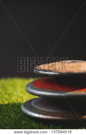 Close up of discuses on grass