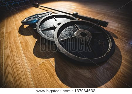 Close up of barbell on wooden floor